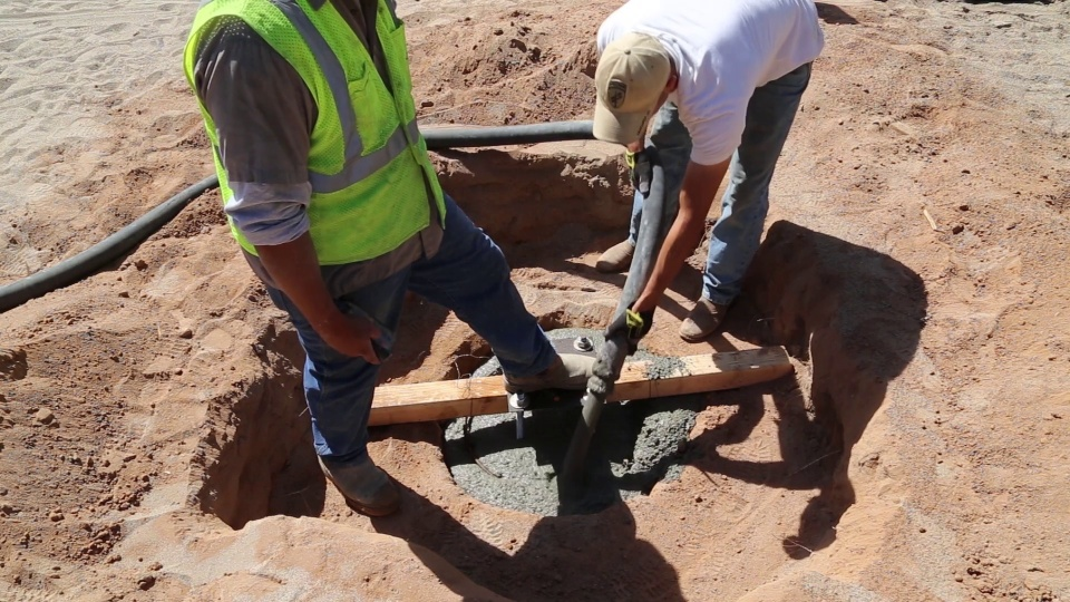How to Pour a Concrete Footing for a Shade Structure